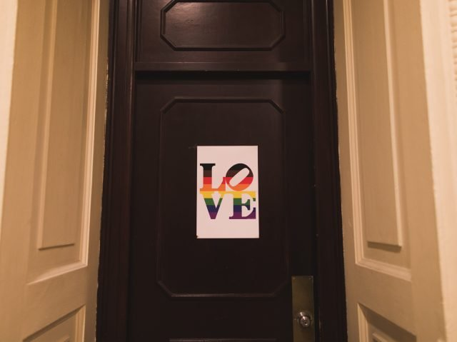 photo of LOVE sign in pride colors on City Hall door in Philadelphia