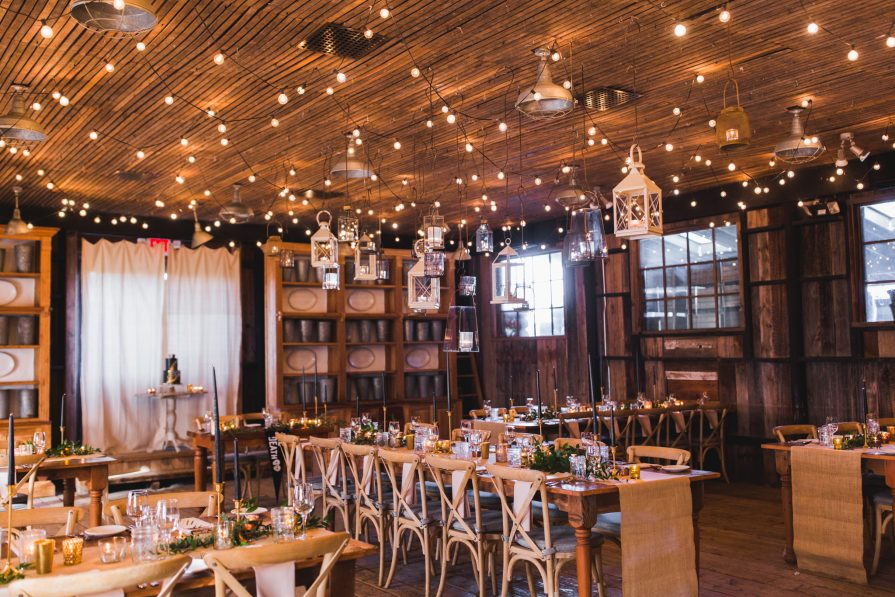The Garden Shed at Terrain's rustic reception room, with twinkling lights, lanterns, and warm rustic details.