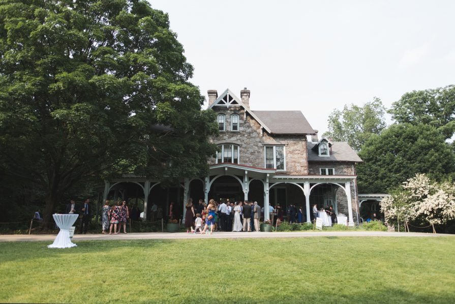 Guests mingle during an afternoon cocktail hour outside of The Francis Cope House at Awbury Arboretum.