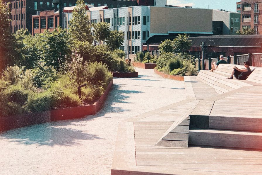 Rail Park, an elevated gravel and boardwalk space that stretches outdoors from 1300 Noble Street up onto the Viaduct.