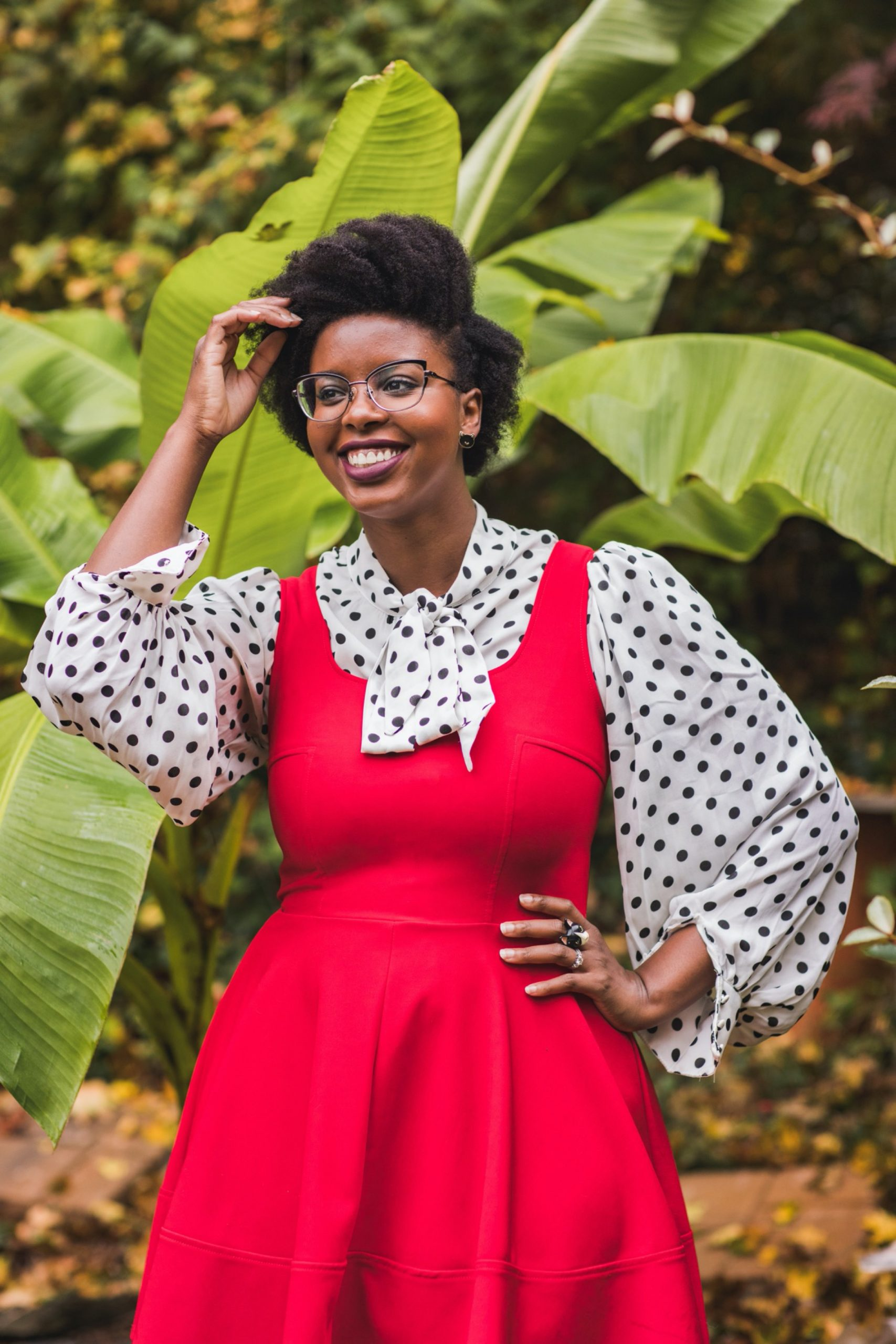 Philadelphia portrait photographer, branding session with Liz, a Black woman who wears a red dress with black and white polka dot blouse